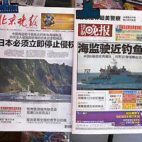 BEIJING, SEPTEMBER -14 : newspapers with the latest news about the Diaoyu Islands are seen at a newsstand in Beijing . China  strongly condems Japan's 'nationalizing' of the Diaoyu islands, known as the Senkaku Islands in Japan. China has dispatched two patrol ships to 'assert its sovereignty' over islands at the centre of a row with Japan.