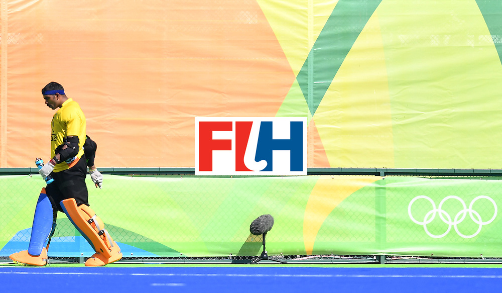 India's Sreejesh Parattu leaves the pitch at the end of the men's quarterfinal field hockey Belgium vs India match of the Rio 2016 Olympics Games at the Olympic Hockey Centre in Rio de Janeiro on August 14, 2016. / AFP / MANAN VATSYAYANA        (Photo credit should read MANAN VATSYAYANA/AFP/Getty Images)