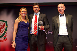 CARDIFF, WALES - Monday, October 5, 2015: Wales' manager Chris Coleman receives his Media Choice award from Kate Suddards and head of pubic affairs Ian Gwyn Hughes during the FAW Awards Dinner at Cardiff City Hall. (Pic by David Rawcliffe/Propaganda)