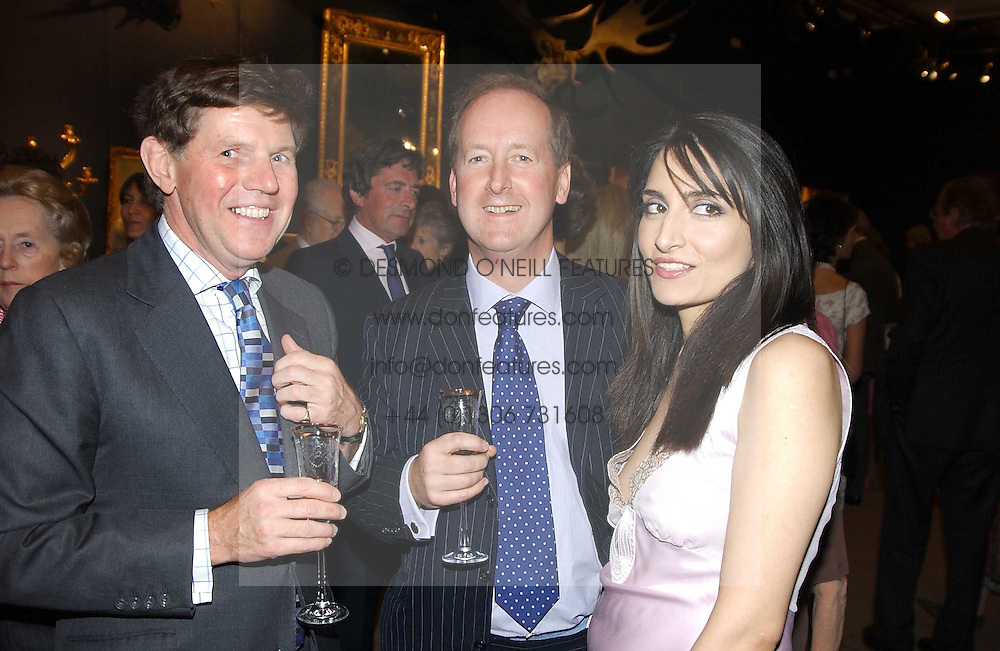 Left to right, IAN SHACKLETON, LORD NORTHBROOK and RENU MEHTA at auctioneers Sotheby's Summer party held at their showrooms in 34-35 New Bond Street, London W1 on 6th June 2005.<br /><br />NON EXCLUSIVE - WORLD RIGHTS