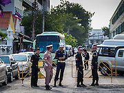 07 JULY 2015 - BANGKOK, THAILAND:  Thai military police wait for students arrested for violating military orders to arrive at the Ministry of Defense from the jail before their hearing. About 100 people gathered in front of the Ministry of Defense in Bangkok Tuesday to support 14 university students arrested two weeks ago for violating orders against political assembly. They're facing criminal trial in military courts. The courts ordered their release Tuesday because they can only be held for two weeks without trial, the two weeks expired Tuesday and the military court chose not to renew their pretrial detention. The court order was not an acquittal. They still face trial and possible prison sentences if convicted.       PHOTO BY JACK KURTZ