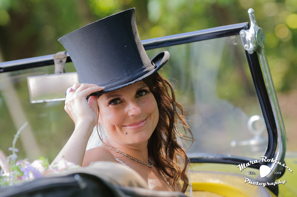 bride in yellow car 1927 Dodge Roadster by Tallmadge wedding photographer, Akron wedding photographer Mara Robinson Photography