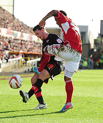 Brentford's Lee Hodson  battles for the ball with Swindon Town's Nathan Byrne - Photo mandatory by-line: Joe Meredith/JMP - Tel: Mobile: 07966 386802 04/05/2013 - SPORT - FOOTBALL - County Ground - Swindon - Swindon Town v Brentford - Npower League one Play Off