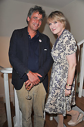 ALEX MICHAELIS and SUE CREWE at a party to celebrate the publication of 'Garden' by Randle Siddeley held at Linley, 60 Pimlico Road, London on 24th May 2011.