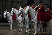 Mounted troops before the Lord Mayor's Show in the City of London, the capital's ancient financial district founded by the Romans in the 1st Century. This is the pageant's 800th birthday and the 250 year-old horse-drawn guided State Coach will be pulled through the medieval streets with the newly-elected Mayor along with 7,000 others. This first took place in 1215 making it the oldest and longest civil procession in the world which survived both Bubonic plague and the Blitz.