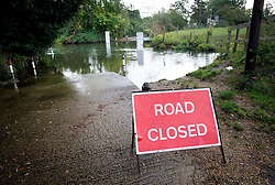 © London News Pictures. 17/10/2012. Charvil, UK. A road closed sign at a ford on the River Loddon at Charvil in Berkshire where the road has flooded on October 17, 2012 following heavy rain last night. Photo credit : Ben Cawthra /LNP