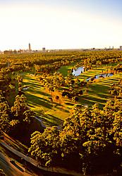 Stock photo of an aerial view of the Hermann Park golf course in the late afternoon as the sun goes down