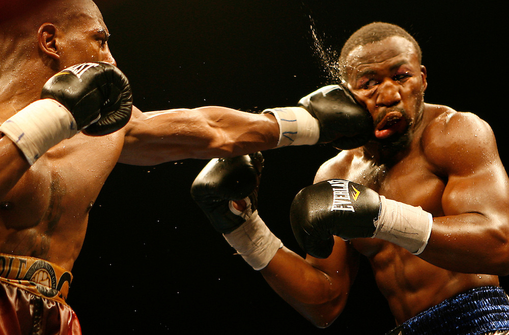 (04/10/2009 Tampa) Otis Griffin jars Jeff Lacy with a left hand in their fight at the University of South Florida Sundome Friday, April 10. [WILLIE J. ALLEN JR., Times].
