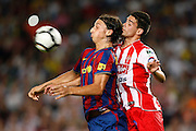 FC Barcelona's Zlatan Ibrahimovic (l) and Sporting de Gijon's Alberto Tomas Botia during La Liga match.August 31 2009.