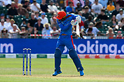 Mujeeb Ur Rahman of Afghanistan fends off a short ball from Pat Cummins of Australia during the ICC Cricket World Cup 2019 match between Afghanistan and Australia at the Bristol County Ground, Bristol, United Kingdom on 1 June 2019.