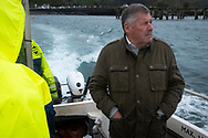 'Don on the ferry, 2018' from Colin McPherson's project 'Treasured Island' part of the Document Scotland exhibition entitled 'A Contested Land' which will launch at the Martin Parr Foundation, Bristol, on 16th January, 2019. McPherson's work was made in 2018-2019 on Easdale, the smallest permanently inhabited Inner Hebridean island and looks at the historical legacy of the island, once world famous for its slate mining industry.<br /> <br /> Photograph © Colin McPherson, 2018 all rights reserved.