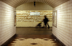 UK ENGLAND LONDON OCT98 - A woman pushes a pram in the South Kensington underground tunnel. Over a million passengers use the London Underground each day.   ..The London Underground is a rapid transit system serving a large part of Greater London and neighbouring areas of Essex, Hertfordshire and Buckinghamshire in the UK. The Underground has 270 stations and about 400 km of track, making it the longest metro system in the world by route length; it also has one of the highest number of stations and transports over three million passengers daily...jre/Photo by Jiri Rezac..© Jiri Rezac 1998
