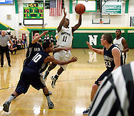 Northmont junior Keith Richardson (11) takes a shot in the third period as the Fairmont Firebirds play the Northmont Thunderbolts at Northmont High School in Clayton, Friday, December 16, 2011.