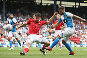 Charlton Athletic defender Tom Lockyer (5) gets the block on the shot from Blackburn Rovers forward Adam Armstrong (7) during the EFL Sky Bet Championship match between Blackburn Rovers and Charlton Athletic at Ewood Park, Blackburn, England on 3 August 2019.