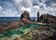 A man swims in St. Paul's Pool, a natural pool found along the coast of the volcanic landscape of Pitcairn island.