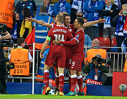 LIVERPOOL, ENGLAND - Wednesday, August 23, 2017: Liverpool's Emre Can celebrates scoring the first goal with team-mates Roberto Firmino and captain Jordan Henderson during the UEFA Champions League Play-Off 2nd Leg match between Liverpool and TSG 1899 Hoffenheim at Anfield. (Pic by David Rawcliffe/Propaganda)