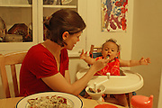 Mother Helps One Year Old Eat Solids
