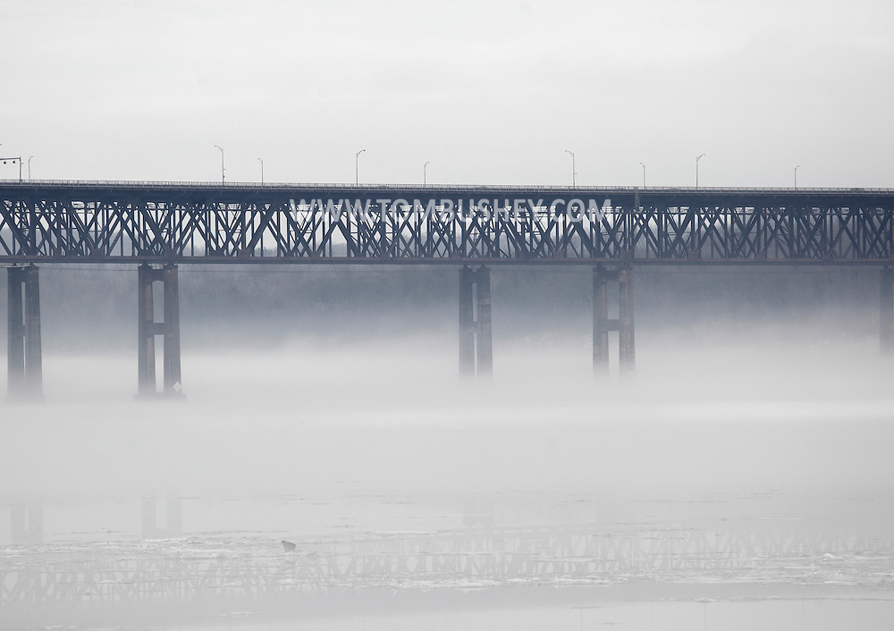 Newburgh, New York -  Fog covers the Hudson River by the Newburgh-Beacon bridge on a warm winter day on Jan. 2, 2010.