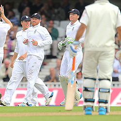 England's Chris Woakes  celebrates and is congratulated by team mates after the wicket of India's Ravichandran Ashwin during the first day of the Investec 5th Test match between England and India at the Kia Oval, London, 15th August 2014 © Phil Duncan | SportPix.org.uk