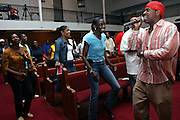Hip Hop legend, Kurtis Blow, 47, is singing while Christian devotees are dancing at his beat, during a Mass Service at the Hip Hop Church in Harlem, New York, NY., on Thursday, June 29, 2006. A new growing phenomenon in the United States, and in particular in its most multiethnic city, New York, the Hip Hop Church is the meeting point between Hip Hop and Christianity, a place where ?God? is worshipped not according to religious dogmatisms and rules, but where the ?Holy Spirit? is celebrated by the community through young, unique, passionate Hip Hop lyrics. Its mission is to present the Christian Gospel in a setting that appeals to both, those individuals who are confessed Christians, as well as those who are not regularly attending traditional Services, while helping many youngsters from underprivileged neighbourhoods to feel part of a community, to make them feel loved and to help them not to give up when problems arise. The Hip Hop Church is not only forward-thinking but it also has an important impact where life at times can be difficult and deceiving, and where young people can be easily influenced for the worst purposes. At the Hip Hop Church, members are encouraged to sing, dance and express themselves in any way that the ?Spirit of God? moves them. Honours to students who have overcome adversity, community leaders, church leaders and some of the unsung pioneers of Hip Hop are common at this Church. Here, Hip Hop is the culture, while Jesus is the centre. Services are being mainly in Harlem, where many African Americans live; although the Hip Hop Church is not exclusive and people from any ethnic group are happily accepted and involved with as much enthusiasm. Rev. Ferguson, one of its pioneer founders, has developed ?Hip-Hop Homiletics?, a preaching and worship technique designed to reach the children in their language and highlight their sensibilities, while bringing forth Christianity. This ?Keep It Real? evangelism style is the centrepiece of Rev. Ferguson