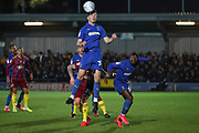 AFC Wimbledon midfielder Callum Reilly (33) winning header during the EFL Sky Bet League 1 match between AFC Wimbledon and Ipswich Town at the Cherry Red Records Stadium, Kingston, England on 11 February 2020.