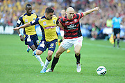 21.04.2013 Sydney, Australia. Mariners defender Pedj Bojic  and Wanderers Croatian forward Dino Kresinger in action during the Hyundai A League grand final game between Western Sydney Wanderers FC and Central Coast Mariners FC from the Allianz Stadium.Central Coast Mariners won 2-0.