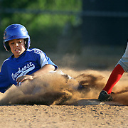 A runner slides into second base during the Norwalk Little League baseball competition at Broad River Fields, Norwalk, Connecticut. USA. Photo Tim Clayton