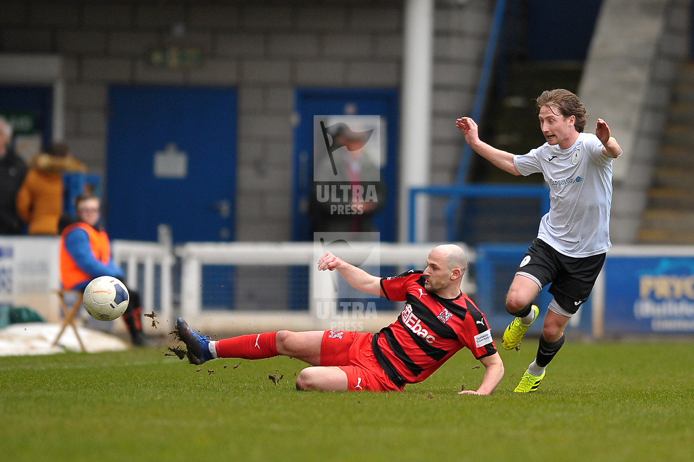 TELFORD COPYRIGHT MIKE SHERIDAN Will Hatfield tackles James McQuilkin of Telford during the Vanarama Conference North fixture between AFC Telford United and Darlington at The New Bucks Head on Saturday, March 7, 2020.<br /> <br /> Picture credit: Mike Sheridan/Ultrapress<br /> <br /> MS201920-049