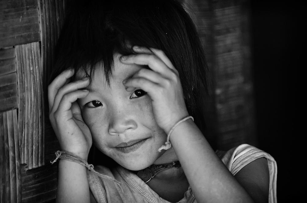 A shy Khamu girl near Nong Kiau, Laos.