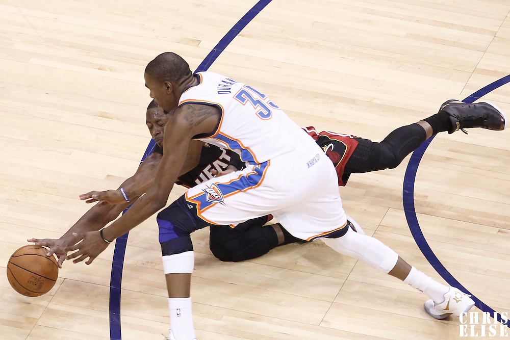 14 June 2012: Miami Heat shooting guard Dwyane Wade (3) dives for the loose ball against Oklahoma City Thunder small forward Kevin Durant (35) during the Miami Heat 100-96 victory over the Oklahoma City Thunder, in Game 2 of the 2012 NBA Finals, at the Chesapeake Energy Arena, Oklahoma City, Oklahoma, USA.