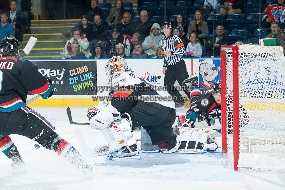 KELOWNA, CANADA - OCTOBER 22: Chris Driedger #33 of the Calgary Hitmen blocks a shot from Tyson Baillie #24 of the Kelowna Rockets on October 22, 2013 at Prospera Place in Kelowna, British Columbia, Canada.   (Photo by Marissa Baecker/Shoot the Breeze)  ***  Local Caption  ***