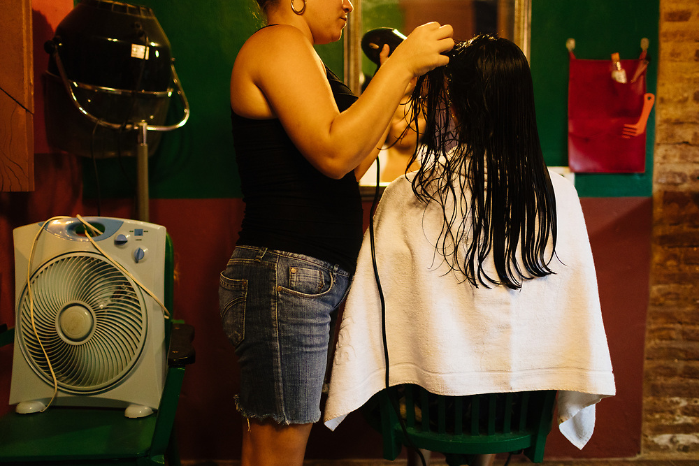 Twenty-somethng girl gets haircut in Trinidad, Cuba