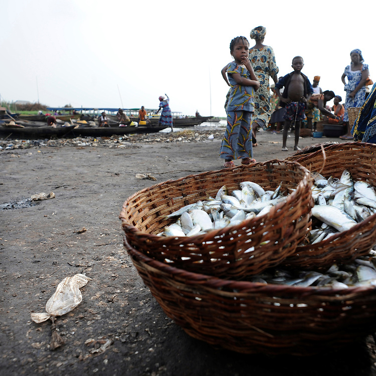 Benin March 1, 2008  Beninese women sell fish along the lagoon of Ganvie