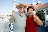 Senior couple holding ice creams