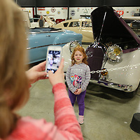 Susanna Sheffield, 5 of Atlanta Georgia, has her picture taken by her mother Sheri, as she stands in front of the 1951 Talbot Lago T26 during their visit to the Tupelo Automobile Museum during its final day open to the public. The Sheffield's made the stop to the museum while in Tupelo visiting family.