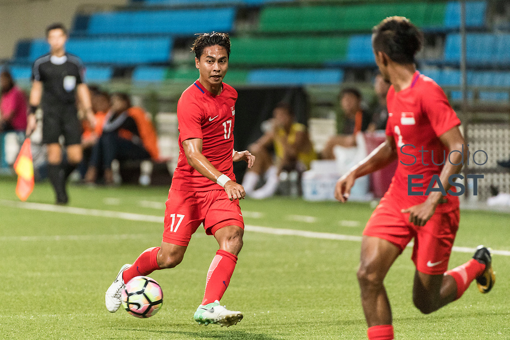SINGAPORE, SINGAPORE - AUGUST 31: Shahril Ishak of Singapore (L) runs with the ball during the international friendly match between Singapore and Hong Kong at the Jalan Besar Stadium on August 31, 2017, in Singapore, Singapore. (Photo by Getty Images)