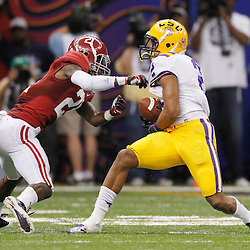 Jan 9, 2012; New Orleans, LA, USA; LSU Tigers wide receiver Rueben Randle (2) is tackled by Alabama Crimson Tide defensive back Dre Kirkpatrick (21) during the second half of the 2012 BCS National Championship game at the Mercedes-Benz Superdome.  Mandatory Credit: Derick E. Hingle-US PRESSWIRE