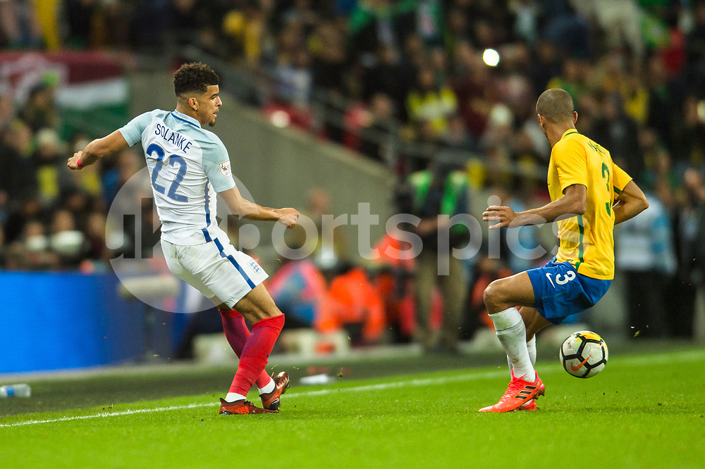 Dominic Solanke of England puts a pass inside and beats Miranda of Brazil during the international friendly match between England and Brazil at Wembley Stadium, London, England on 14 November 2017. Photo by Darren Musgrove.