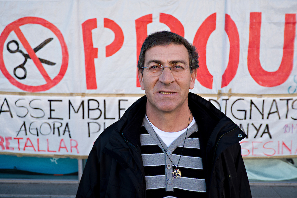 03-01-2013 Sant Pau hospital, Barcelona, Spain. Julio Jansana, ex-hospital worker poses in front of a banner that reads &quot;Enough&quot;. <br />