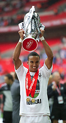 LONDON, ENGLAND - Saturday, May 30, 2011: Swansea City's hat-trick hero Scott Sinclair lifts the trophy after his side beat Reading 4-2 after the Football League Championship Play-Off Final match at Wembley Stadium. (Photo by David Rawcliffe/Propaganda)