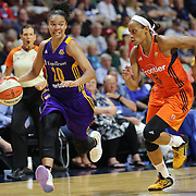 UNCASVILLE, CONNECTICUT- MAY 26:  Kristi Toliver #20 of the Los Angeles Sparks defended by Jasmine Thomas #5 of the Connecticut Sun during the Los Angeles Sparks Vs Connecticut Sun, WNBA regular season game at Mohegan Sun Arena on May 26, 2016 in Uncasville, Connecticut. (Photo by Tim Clayton/Corbis via Getty Images)