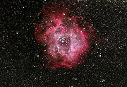 The Rosette Nebula (Caldwell 49) in the constellation Monoceros. The open cluster NGC 2244 lies in the center of the nebula.