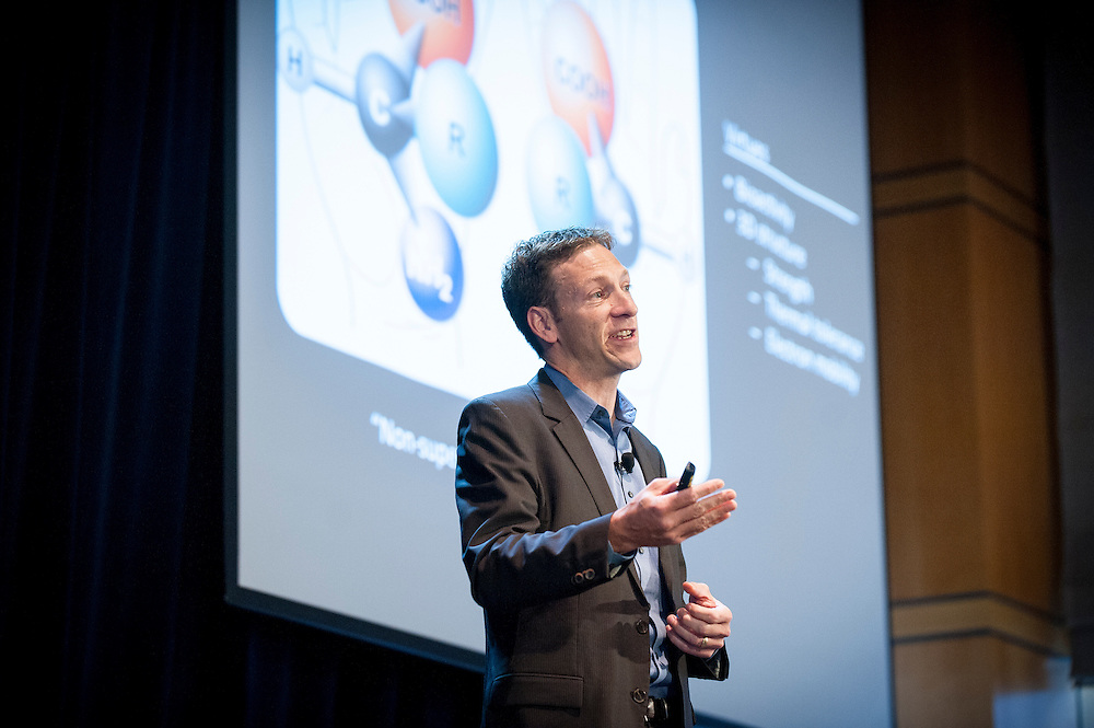 """Zach Serber, Chief Science Officer and Vice President of Development at Zymergen, delivers a keynote address at DARPA's """"Biology Is Technology"""" symposium in New York City on June 23, 2015. The two-day event was held by DARPA's Biological Technologies Office to bring together leading-edge technologists, start-ups, industry, and academic researchers to look at how advances in engineering and information sciences can be used to drive biology for technological advantage."""