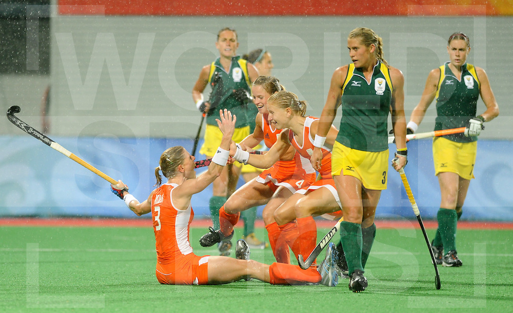 Beijing Olympic Green Hockey Stadium - Hockey.Netherlands - South Africa 6-0.Eefke Mulder scores 1-0 Kate HECTOR is dispointed Fatimah  Moreira de Melo and Janneke Schopman.photo:wsp/Frank Uijlenbroek.