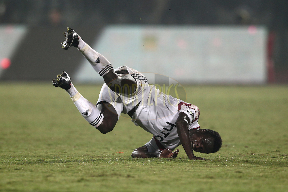 Isaac Chansa of NorthEast United FC fall down during match 40 of the Hero Indian Super League between NorthEast United FC<br /> and Delhi Dynamos FC held at the Indira Gandhi Stadium, Guwahati, India on the 24th November 2014.<br /> <br /> Photo by:  Deepak Malik/ ISL/ SPORTZPICS