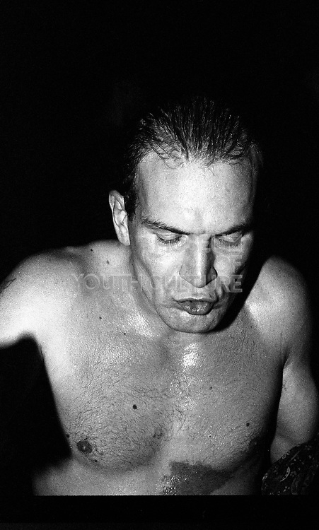 Sweaty man during a rave, High Wycombe, UK, 1980s.