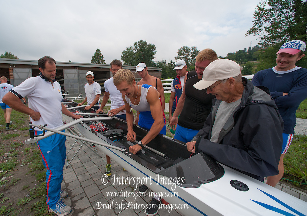 Erba, ITALY M8+. Mike SPRACKLEN, Rigging the new Filippi, with help from the crew, for an outing at the  Russian Rowing Team Training, Italian Base in Erba at Lake Pusiano.  09:41:27  Tuesday  22/07/2014  [Mandatory Credit; Peter Spurrier/Intersport-images]