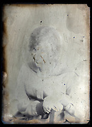 portrait on a severly deteriorating glass plate with retouch markings  France ca 1920s