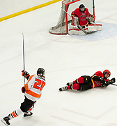 West forward Michael Curran shoots<br /> on the West Valley goal during the first period of the 2015 State Hockey Championships at the Curtis D. Menard Memorial Sports Center Saturday night. WHS won 4-3.