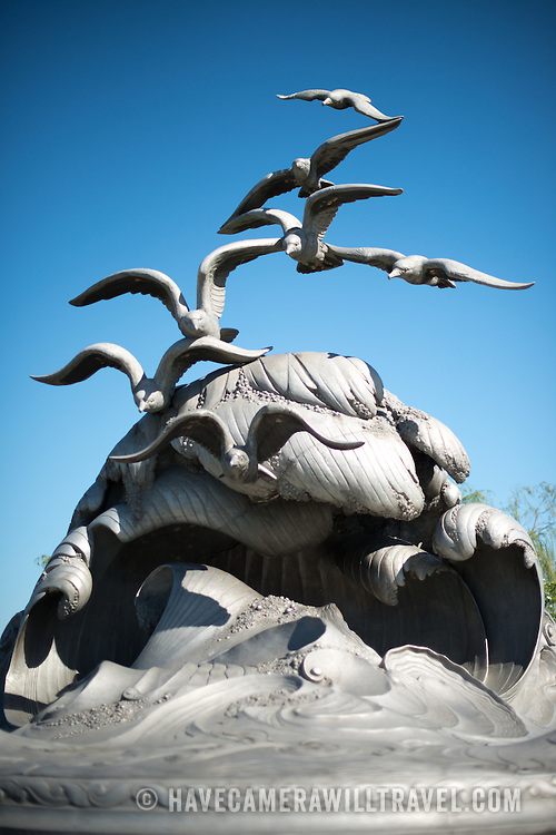 A front view of the cresting wave and seagulls of the Navy-Merchant Marine Memorial in Arlington, Virginia, on Columbia Island on the banks of the Potomac across from Washington DC. The memorial honors those who lost their life at sea in World War I and was dedicated in 1934. The main sculpture is cast from aluminum.